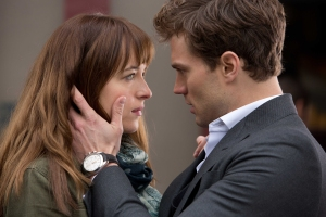 FIFTY SHADES OF GREY - 2014 FILM STILL - DAKOTA JOHNSON as Anastasia Steele and JAMIE DORNAN as Christian Grey - Photo Credit: Chuck Zlotnick   © 2015 Universal Studios and Focus Features. ALL RIGHTS RESERVED.